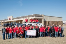 Homes by Taber employees present a check to Anna's House Foundation