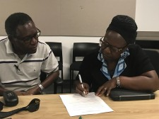Robinah Lubwama is signing agreement with DTML.org